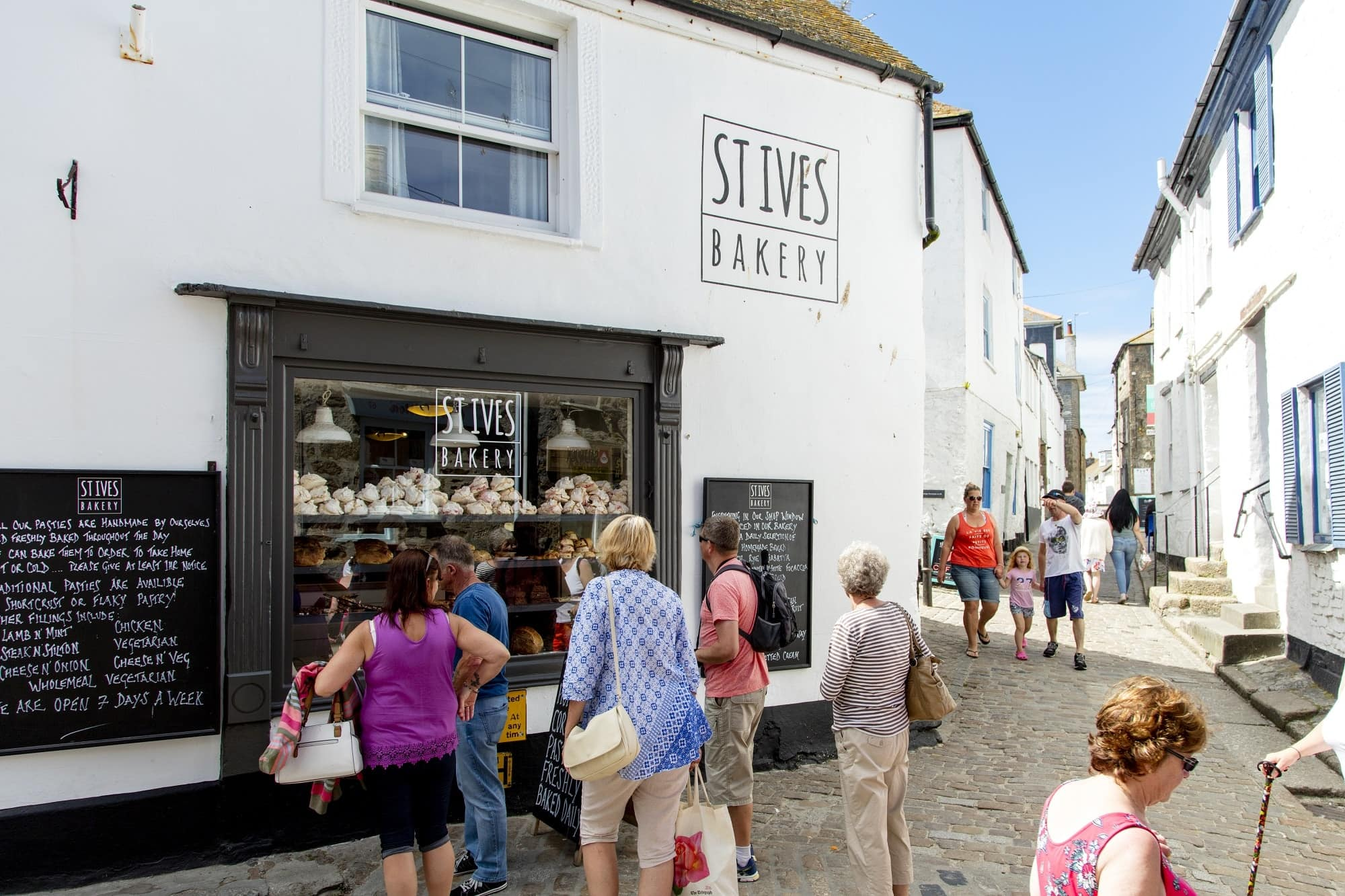 image of small group inspecting the pastries at St.Ives Bakery