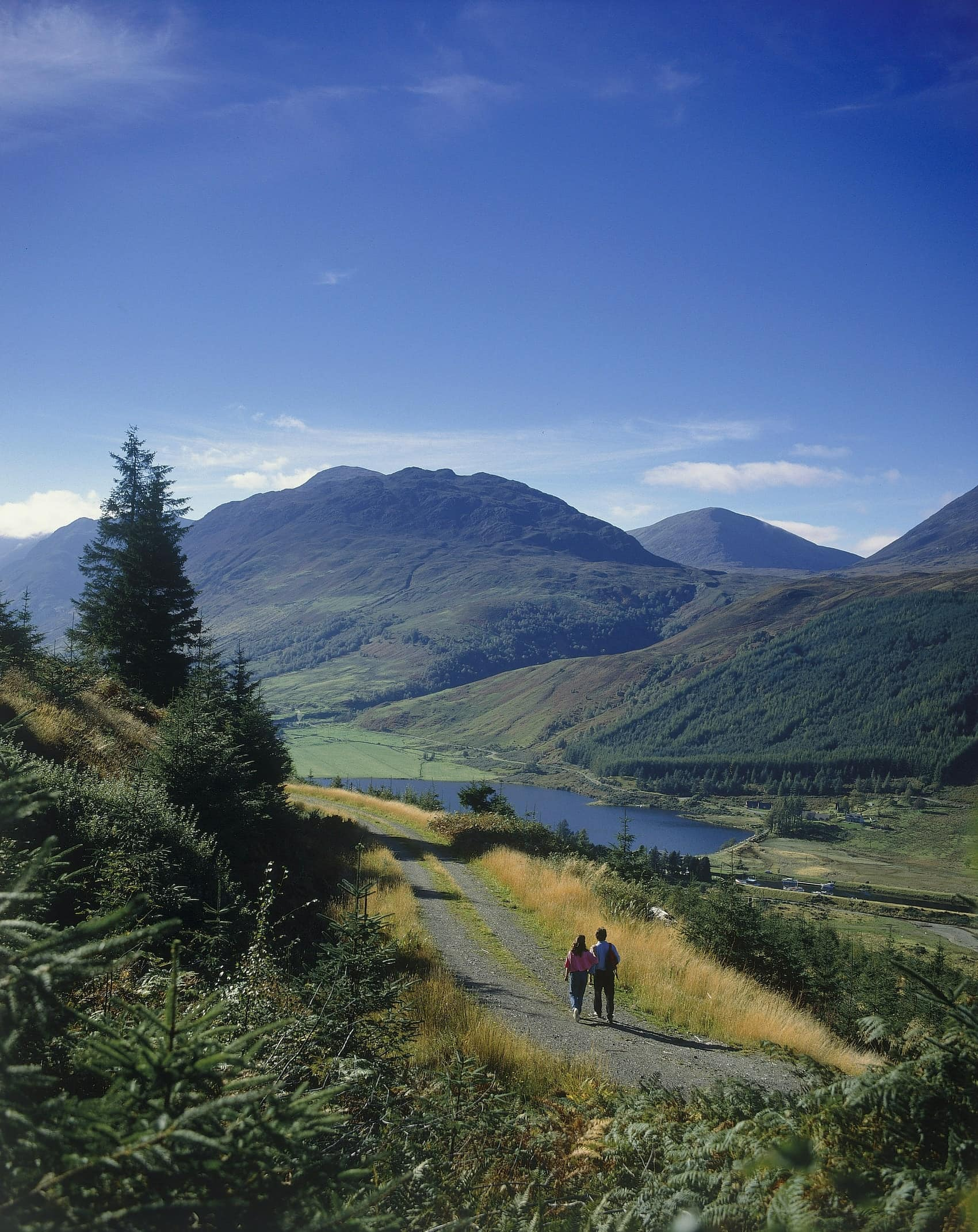 Image of couple walking by loch along the great glen way