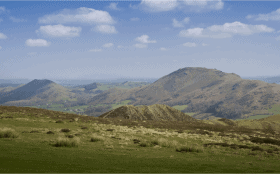 Shropshire Hills singles walking holidays, View from Long mynd, Caer Caradoc in the distance
