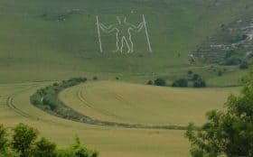 An image of the Long man of Wilmington, a hill figure set along our route through the South Downs Way, South England