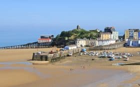 Spring sunshine on Tenby North Beach and harbour, Pembrokeshire, Wales