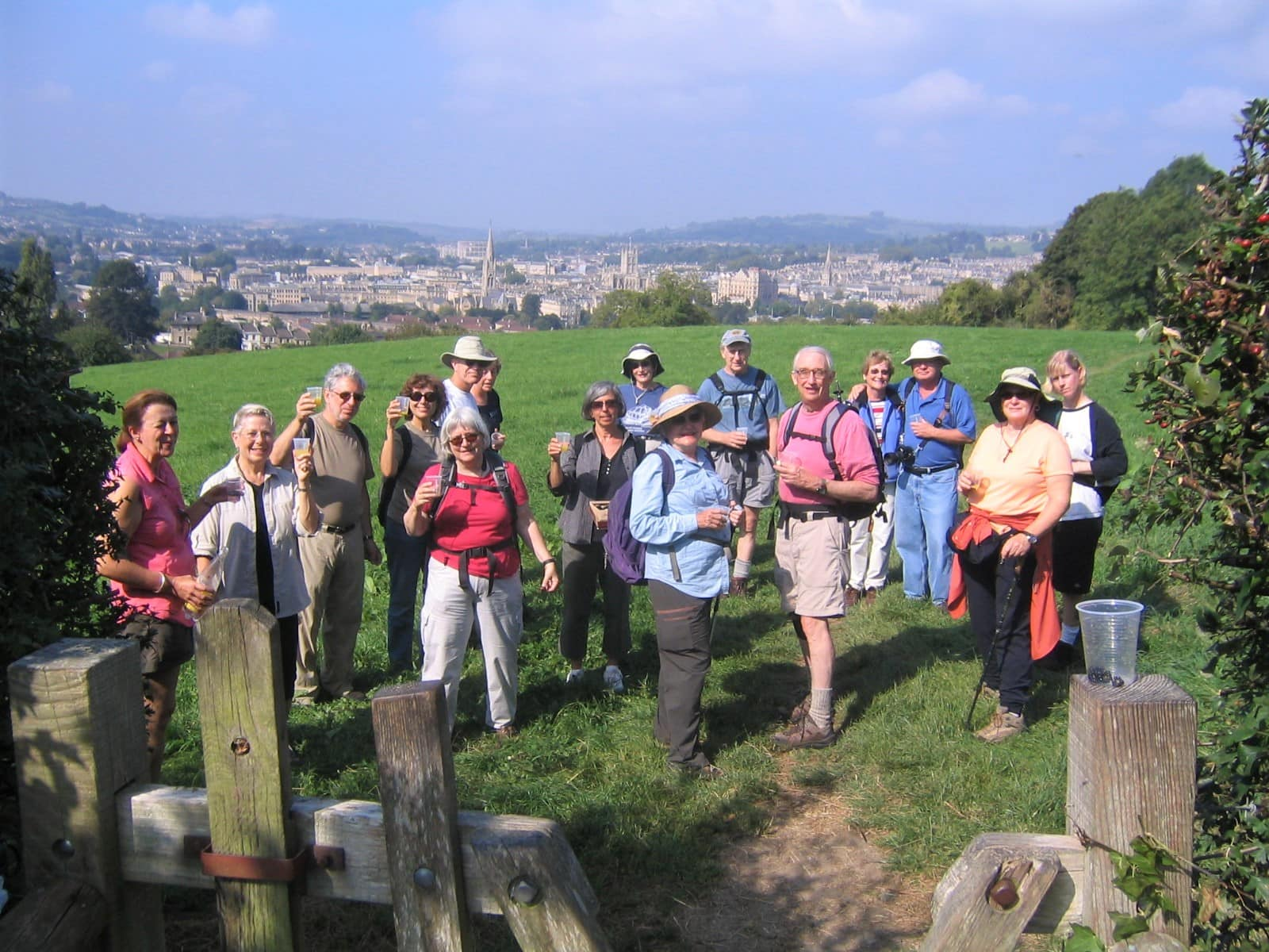Clients celebrating the end of the Cotswolds Way, Bath in background