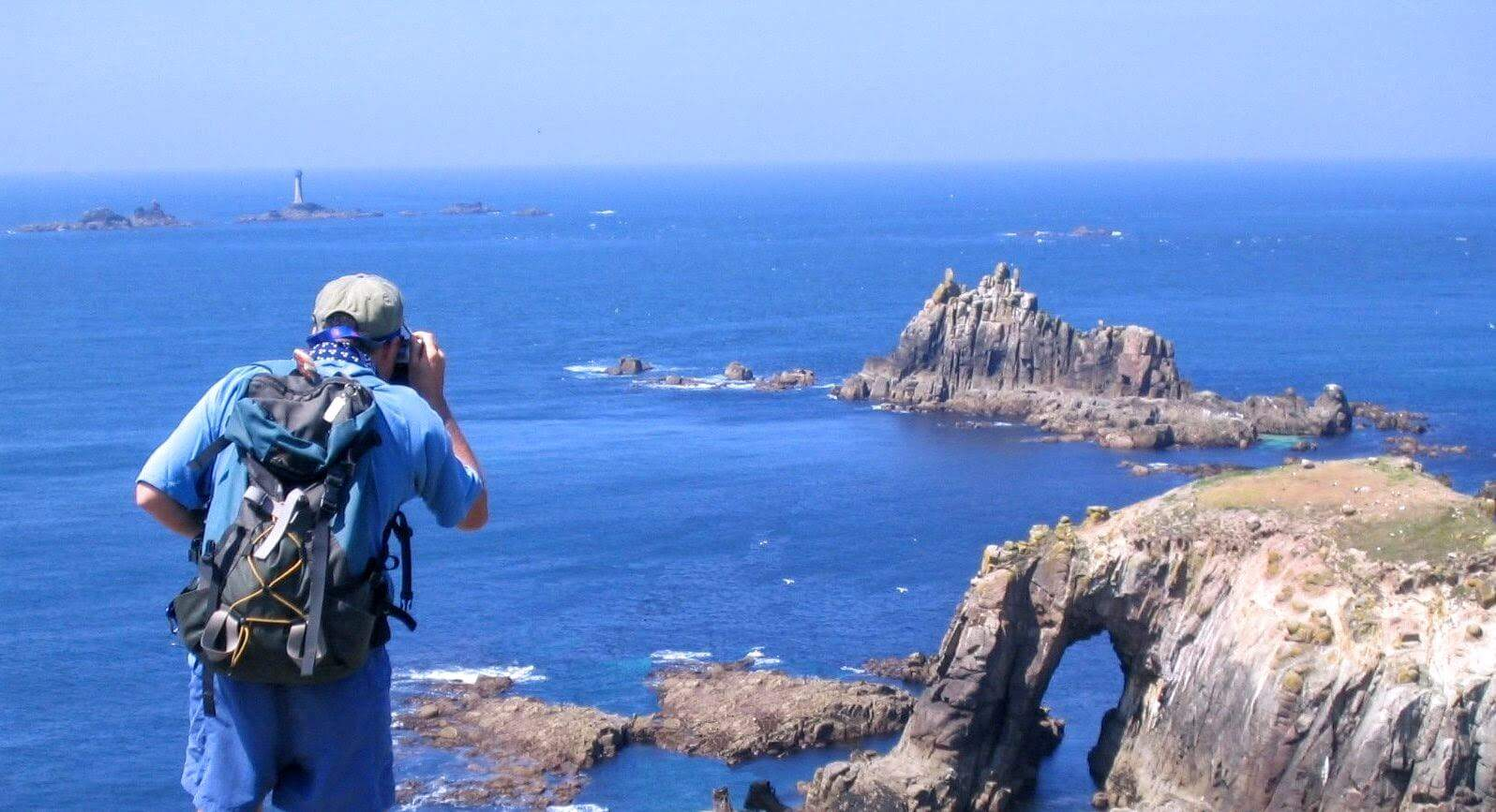 Image of walking with binoculars at lands end