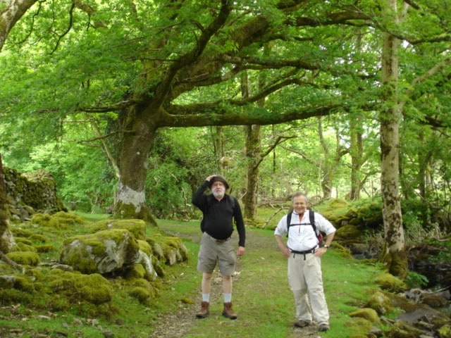 Larry and Benet walking through forest