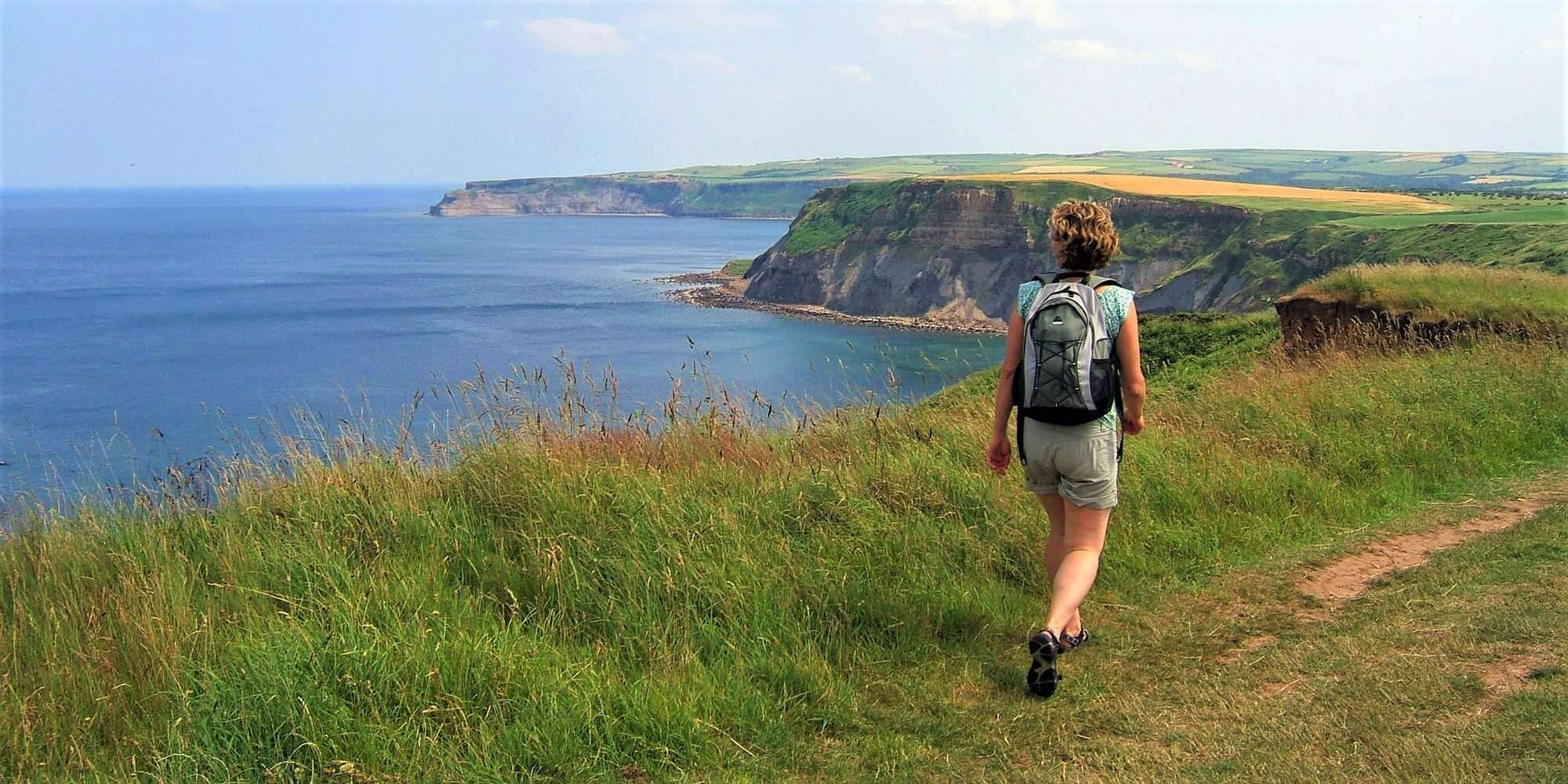 Hiker admiring the views out over the cliffs