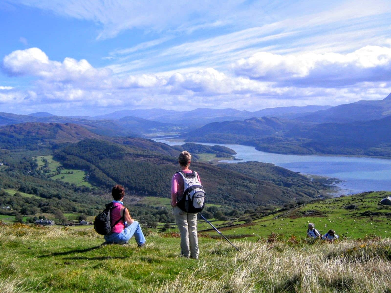 Two women gazing over the Mawddach estuary