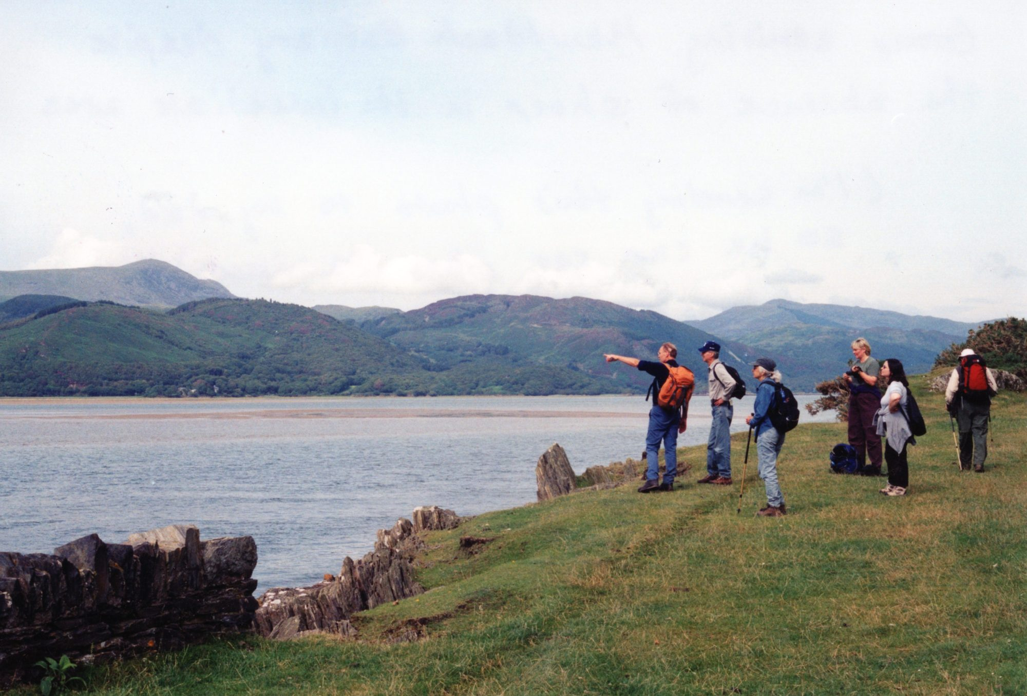 Walkers taking a moment out to discuss aspects of the scenery before them