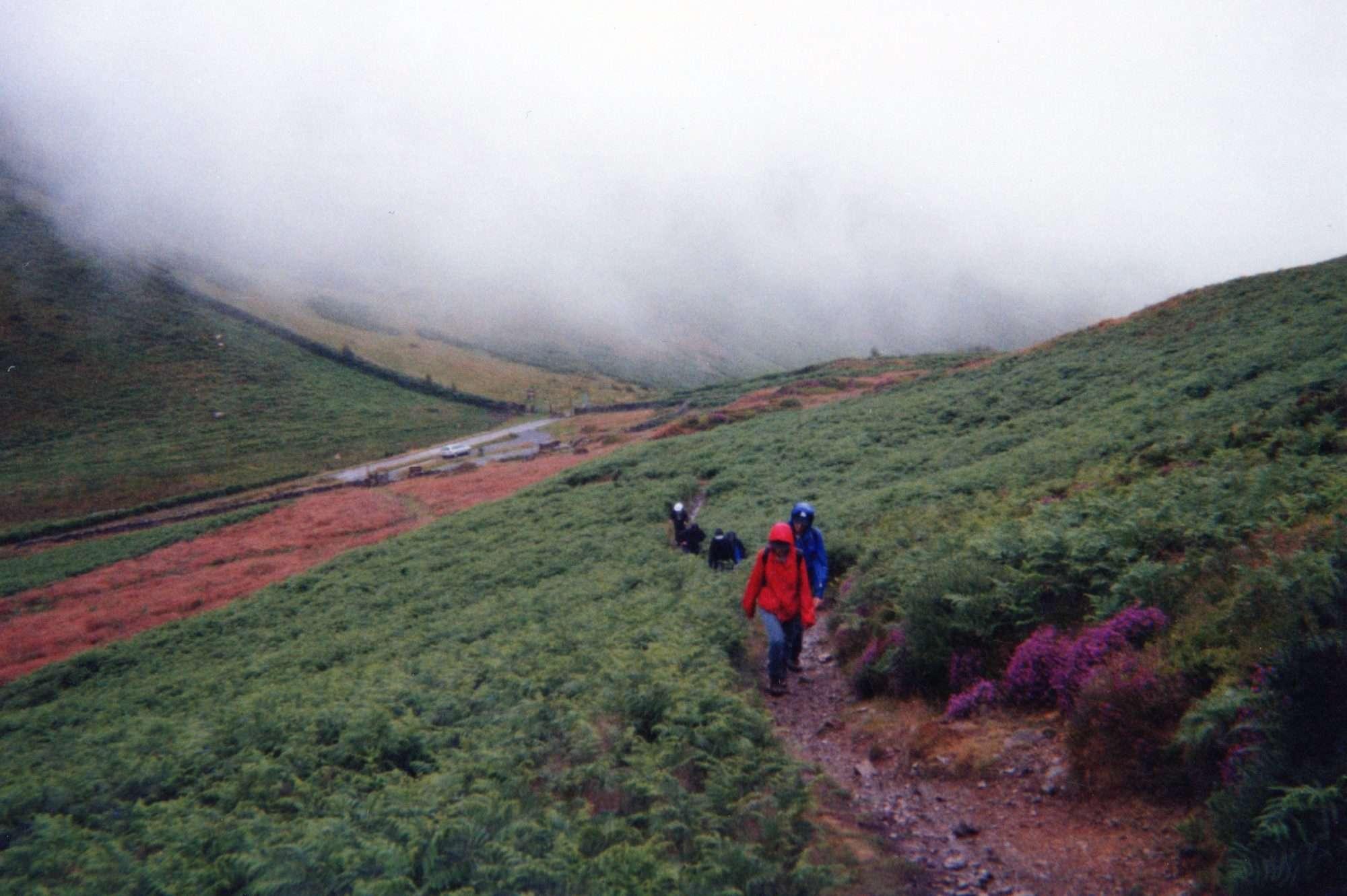 Misty day hiking up hillside