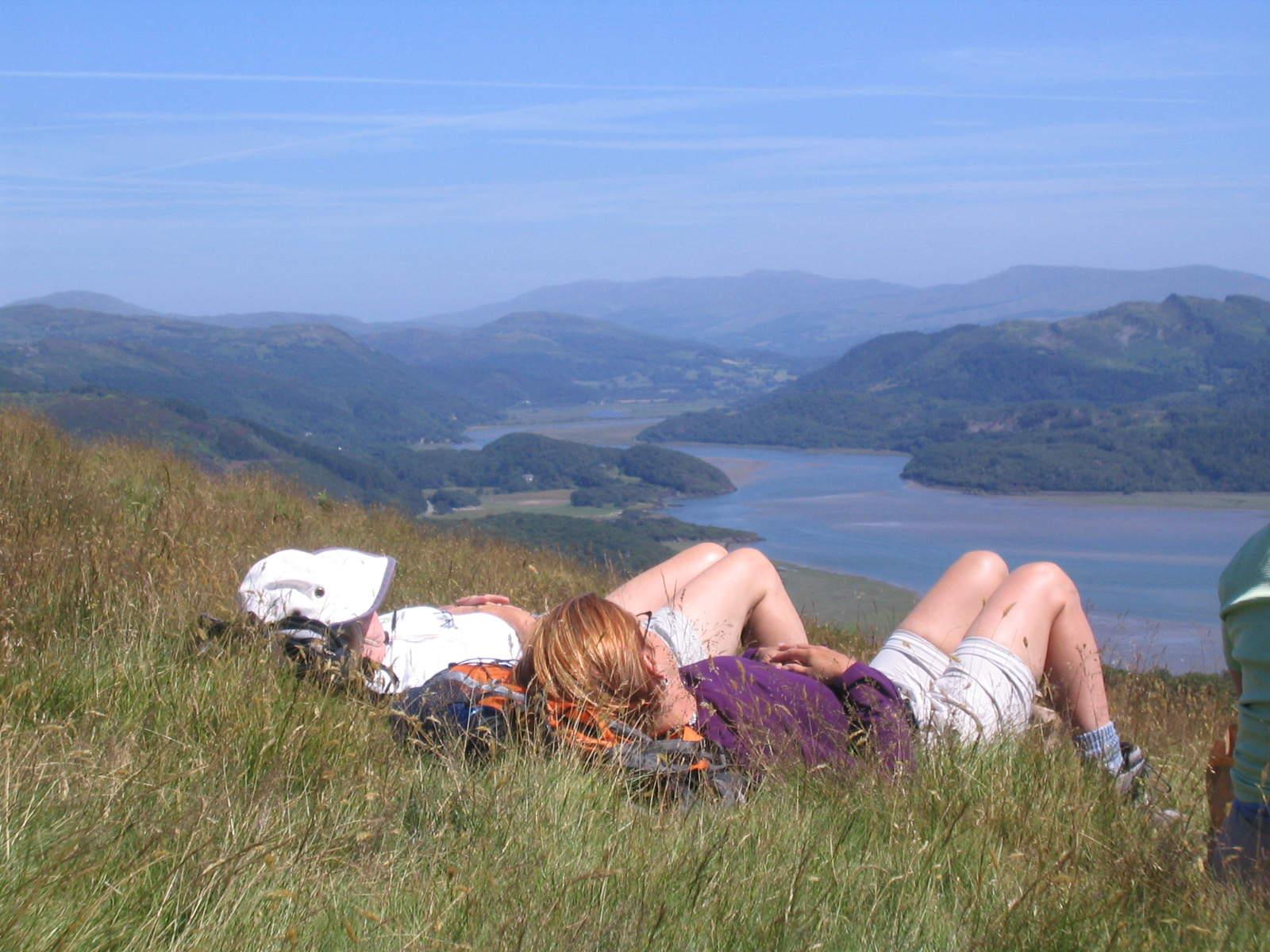 Two women taking a rest by estuary wales July
