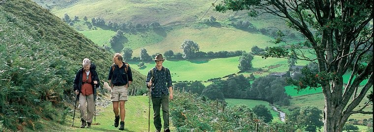 Three hikers travelling through the welsh countryside
