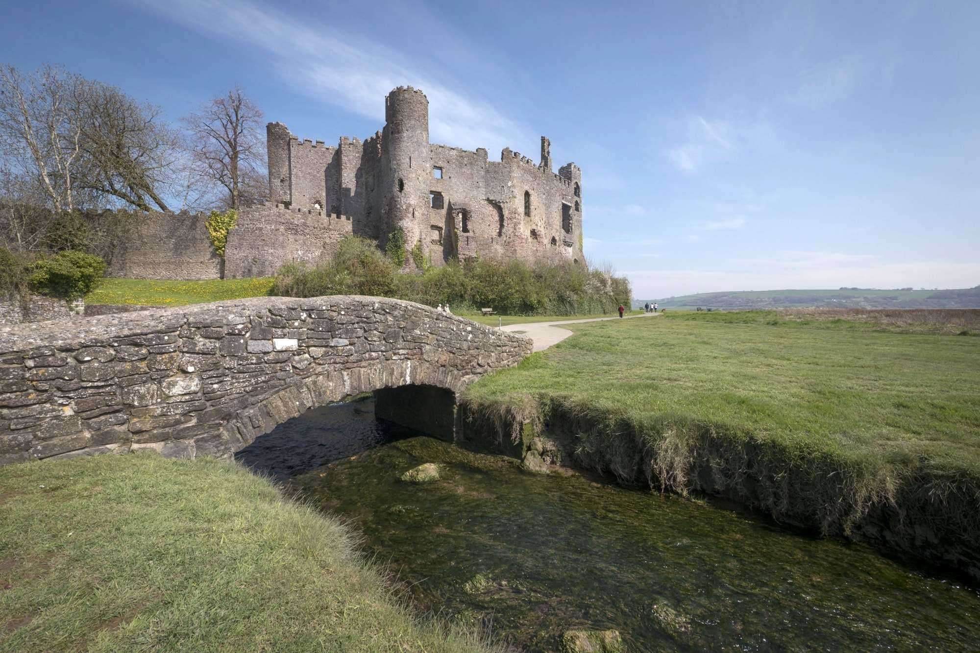 Image of Laugharne Castle, with small bridge over the Taf Estuary