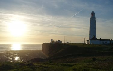 Sunset over Nash Point Lighthouse Wales Coast Path