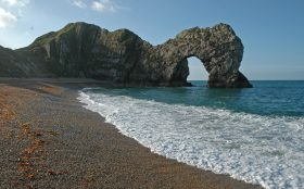 Landscape of Durdle Door on bright sunny day, near Lulworth, Dorset, South England