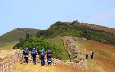 Image of a group walking Hadrian's Wall, North England