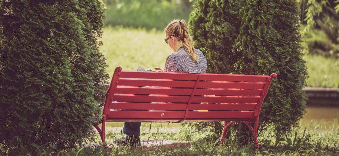 Woman-Reading-on-a-Bench