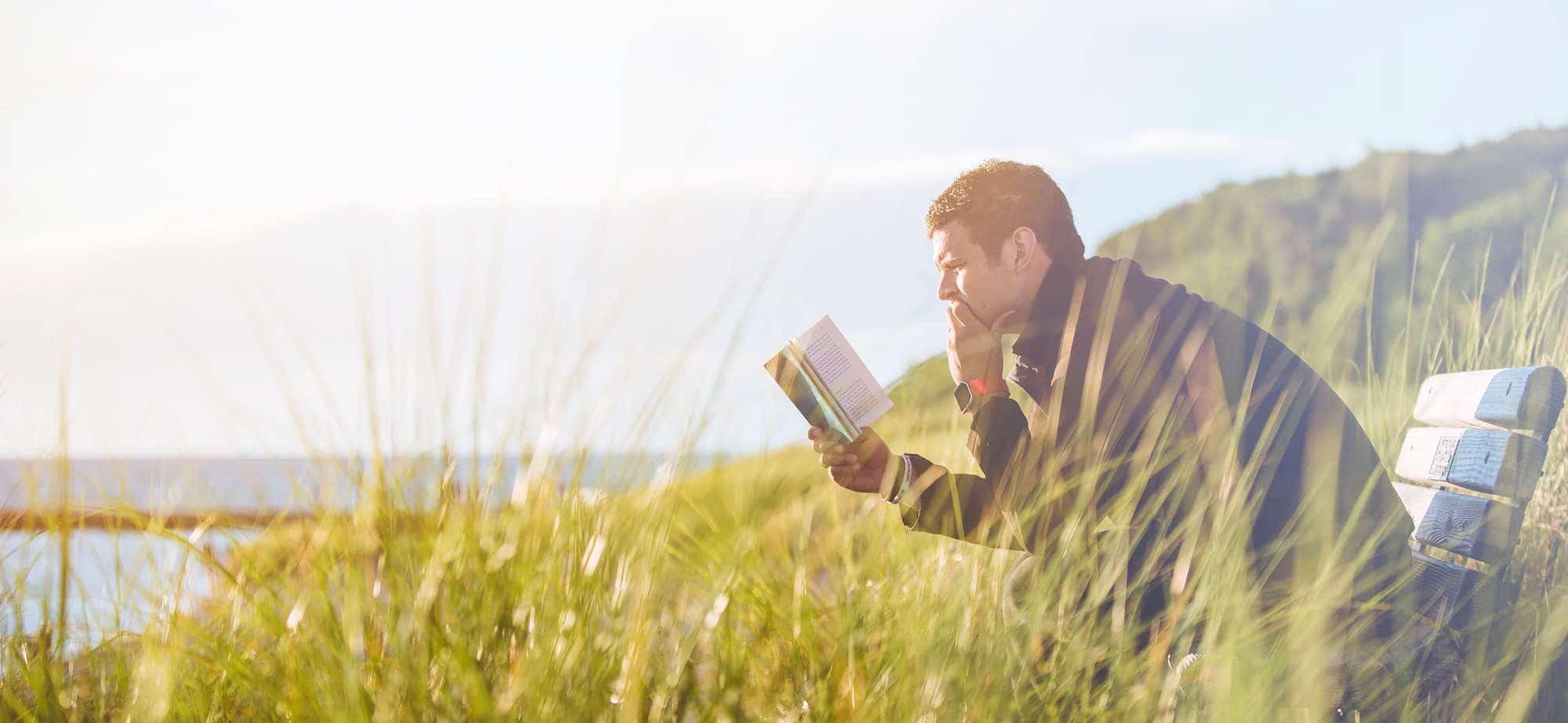 Man reading while hiking