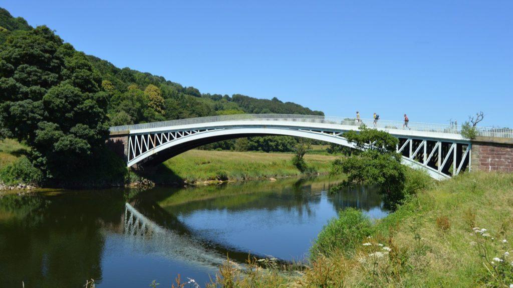 Walkers crossing Bigsweir Bridge