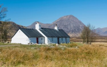 Blackrock Cottage, situated on the access road to the Glencoe mountain ski area with Buachaille Etive Mor seen beyond