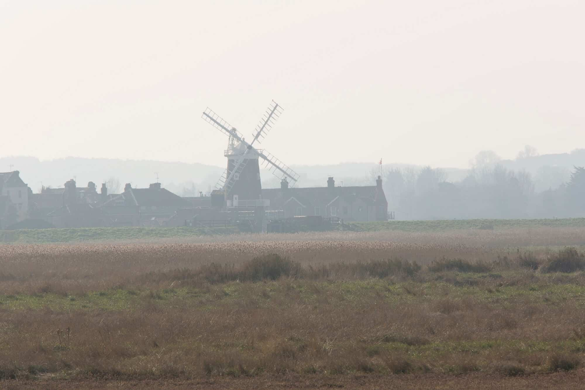 Hiking holidays UK Cley Towermill, as seen from Salthouse Marshes in Norfolk