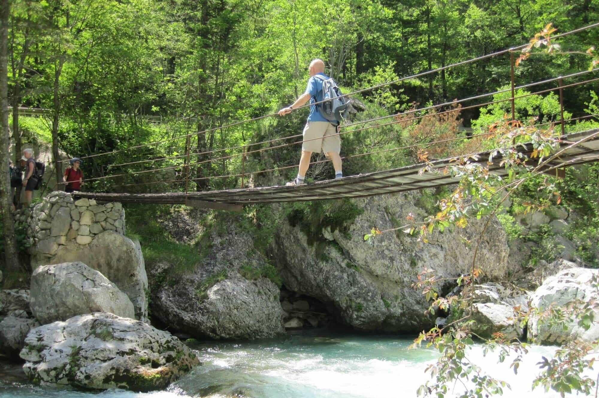 Crossing a rope bridge in Slovenia