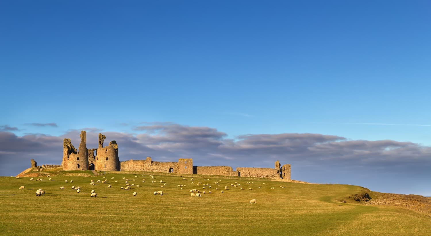 Dunstanburgh Castle Featured 100 walks Britain Blog