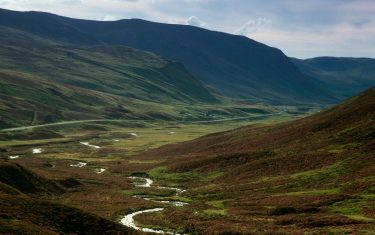 Heather covered moorland of Glenshee, with hills either side of the valley of Perth & Kenross