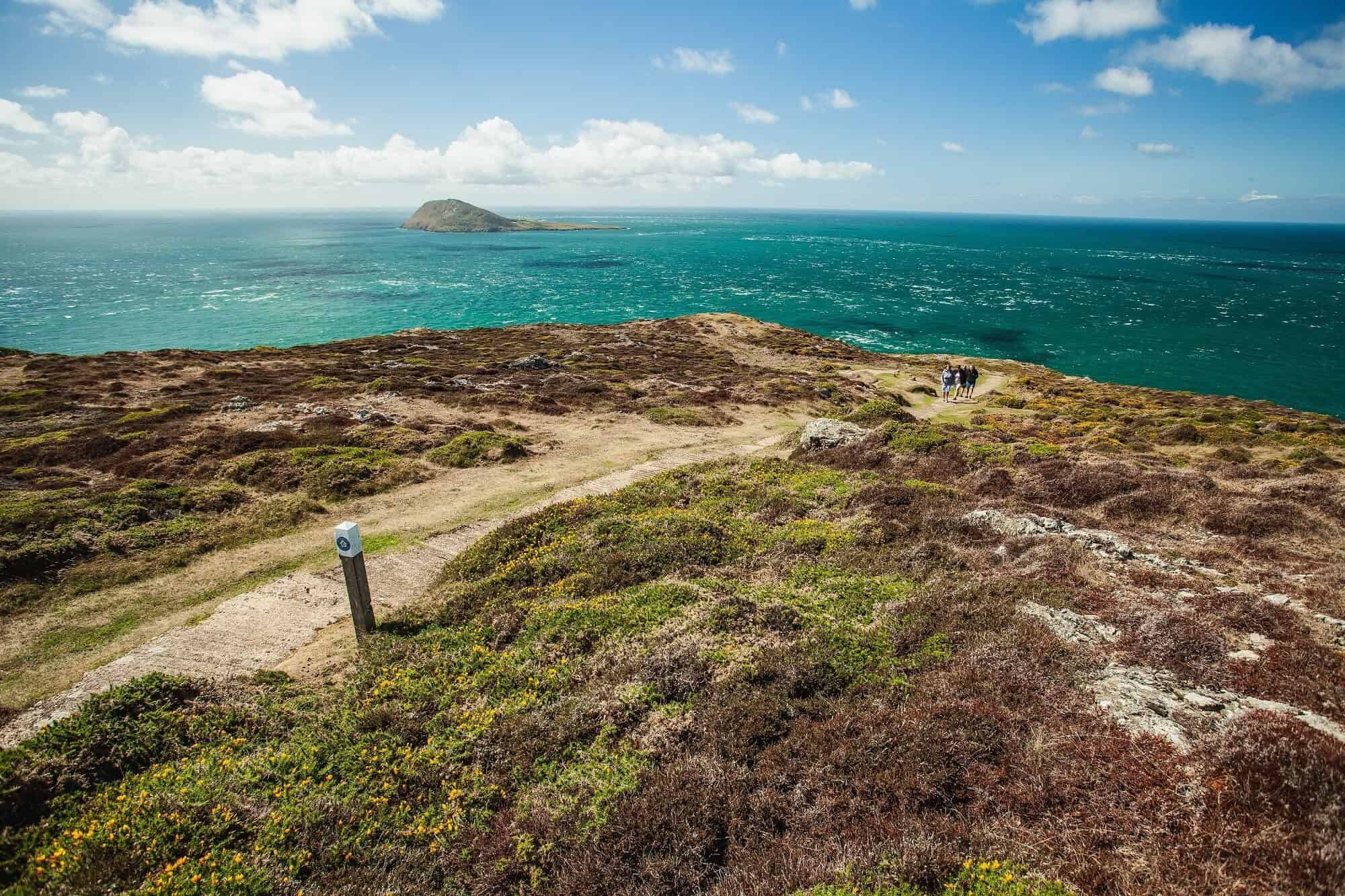 Llyn Coast Path walkers looking out towards Bardsey Island