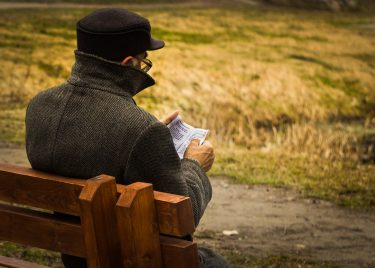 Man Reading Outdoors