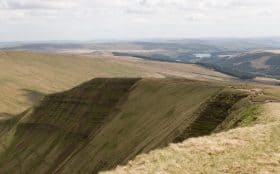 Man walking along Pen Y Fan Ridge
