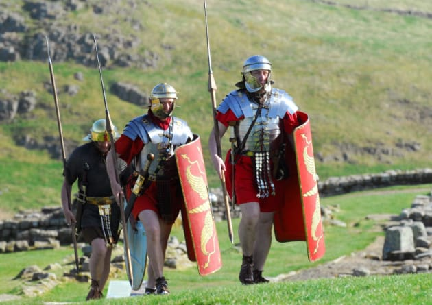 Roman Soldiers walking Hadrian's Wall Path at Housesteads