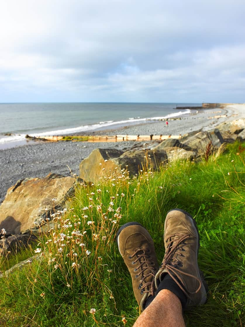 Walker along shores of Ceredigion Coast Path